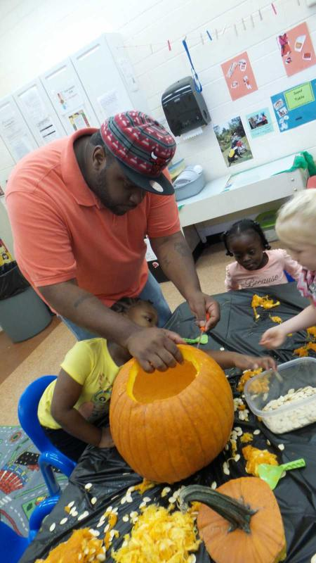 Children get to enjoy fall festivities such as Jack-O-Lantern carving