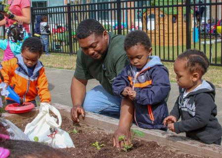 Children learning about and helping with gardening
