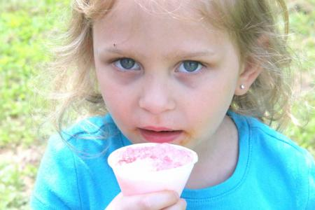 Child enjoying an ice cold snow cone